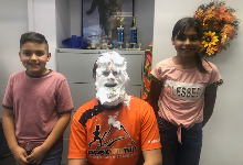 Two Students with Java Jesse, who has shaving cream all over his face.