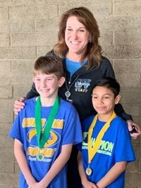 Principal Dodd with two Student Track Winners